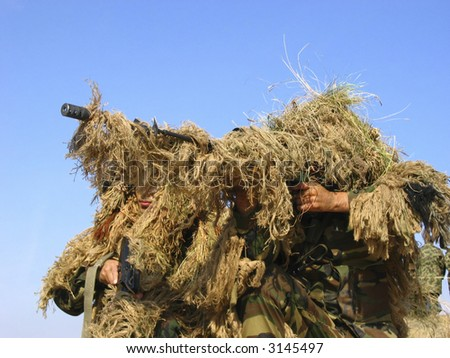 Real Camouflaged Soldier Aiming. Sniper