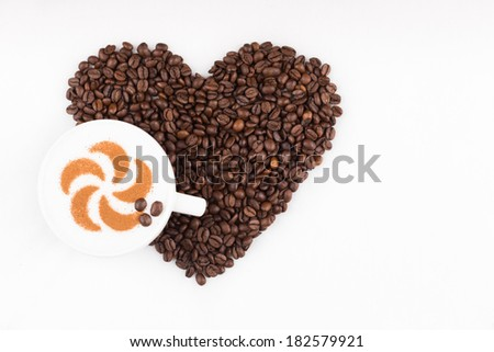 Real capuccino decorated with cinnamon an coffee beans