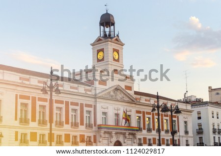 Real Casa de Correos in Puerta del Sol, Madrid. Building is decorated with lgtb flag during gay and lesbian pride week