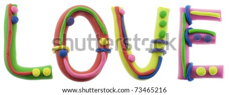 Real cheerful plastic plasticine alphabet- L, O, V, E letters, LOVE word. Isolated on white