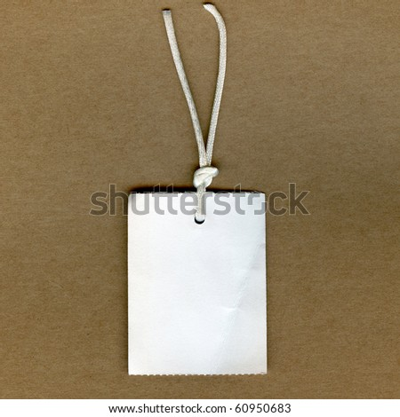 Real Clothing Tag On Brown Paper