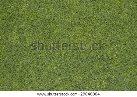 Real colors green tiny cut grass texture, ideal as background for sport, football, soccer, golf, web, 3D video games developers, architecture. Top view.
