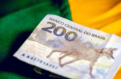 Real currency, money from Brazil. Dinheiro, Reais, Brasil, Real Brasileiro. Brazilian banknote of 200 reais in close-up.