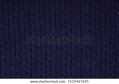 Real deep blue knitted fabric with ornamental pattern textured background