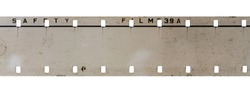 real detail shot of 16mm film strip on white background, cine film macro photo
