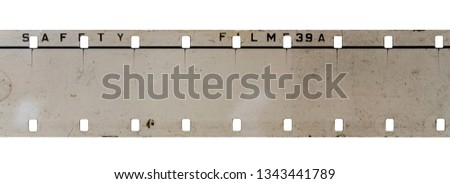 Photo of  real detail shot of 16mm film strip on white background, cine film macro photo
