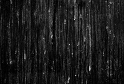Real dirty glass with dust, dirt and rain stains isolated on a black background. For use as layer of old dirty surface in your project.