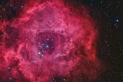 Real emission nebula named Rosette nebula taken with CCD through telescope