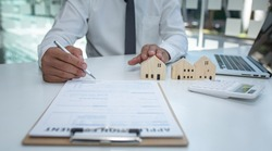 Real estate agent and customer signing contract to buy house, insurance or loan real estate.rent a house,get insurance or loan real estate or property.