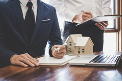 Real estate agent and Sales manager team analysis pricing of rental lease contract of sale purchase agreement, concerning mortgage loan offer for and house insurance.