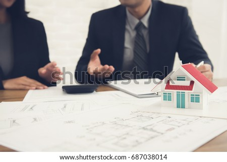 Real estate agent consulting with client - property appraisal and valuation concept