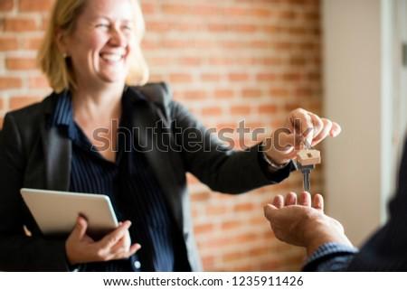 Real estate agent handing over the keys