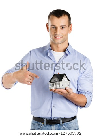 Real estate agent hands small model house, isolated on white