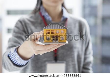 Real estate agent having a residential model