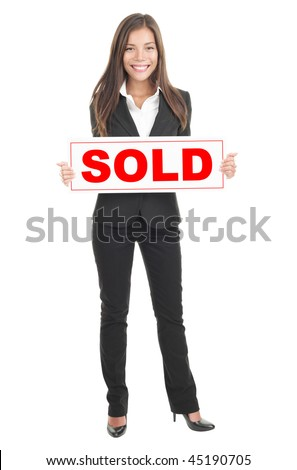 Real estate agent holding sold sign. Isolated in full length on white background. Mixed caucasian / chinese model.