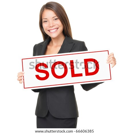 Real estate agent holding sold sign isolated on white background. Beautiful cheerful Asian / Caucasian female realtor smiling confident in black suit.
