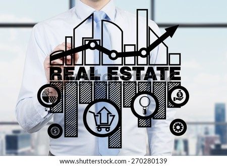 Real estate agent is drawing the chart of the real estate market on the glass screen. #270280139