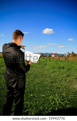 Real estate agent locating a piece of land