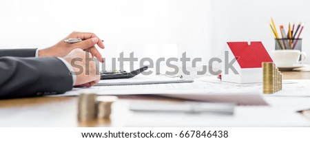Real estate agent working at the table - panoramic banner - Shutterstock ID 667846438