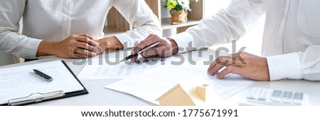 Real estate broker agent presenting and consult to customer to decision making sign insurance form agreement, home model, concerning mortgage loan offer for and house insurance. Photo stock ©
