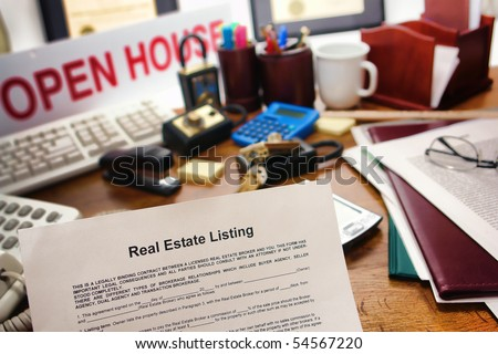 Real estate broker listing contract over busy Realtor desk in realty agent resale office (fictitious document with authentic legal language)