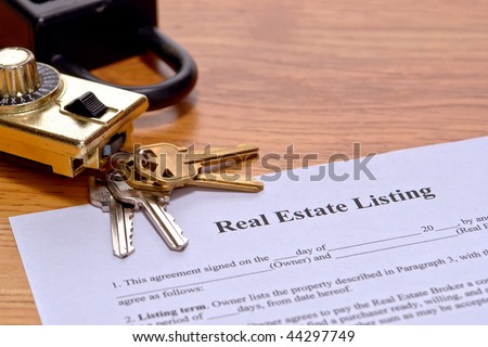 Real estate broker listing home seller document on Realtor desk with house keys and safety showing lock box on realty agent office desk