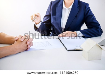 Real estate broker residential agent being analysis and making the decision a home estate loan to customer and waiting for reply to finish house and car rent listing contract. #1121506280