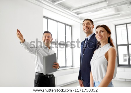 real estate business, sale and people concept - happy smiling realtor with folder showing new office room to customers