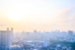 Real estate concept: Abstract blur aerial view city on twilight color sky and clouds cityscape autumn sunrise background. Bangkok, Thailand, Asia