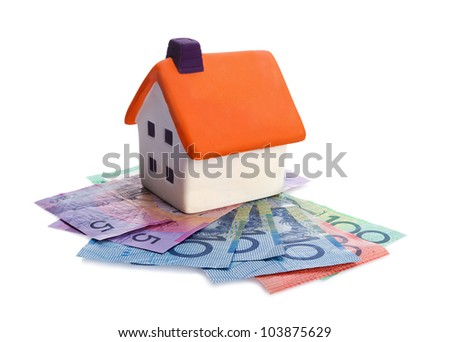 Real estate concept - house and money on white background