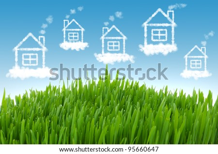 Real estate concept with houses in the sky