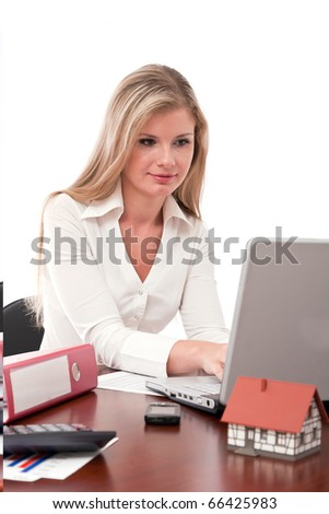 Real estate executive working on laptop