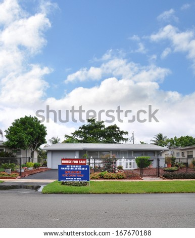 Real Estate For Sale Open House Welcome sign Front yard Lawn Landscaped Suburban home with plants flowers blue sky clouds USA Residential Neighborhood #167670188