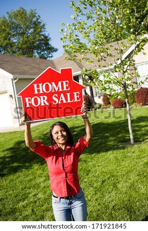 Real Estate: Home Seller Holding Up Sign