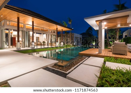 real estate Interior and exterior design of pool villa with swimming pool home, house , building , hotel, resort night time #1171874563