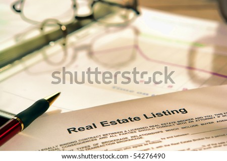 Real estate listing contract on a realtor agent marketing presentation binder