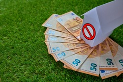 Real estate management. A conceptual house on top of 50 euro bills. Conceptual photography.