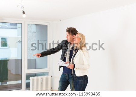 Real estate market - young couple looking for real estate to rent or buy an apartment