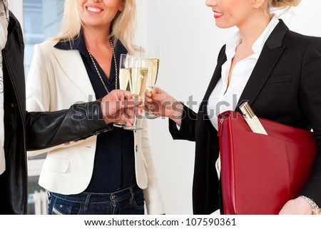 Real estate market - young couple looking for real estate to rent or buy, they celebrate with champagne and clinking glasses