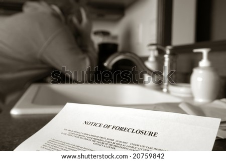 Real estate mortgage lender foreclosure notice on kitchen counter with crying man holding his head in his hands in photo journalistic style (fictitious document with authentic legal language)