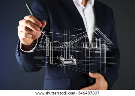 Real estate offer. Businessman drawing a model of the house ストックフォト ©