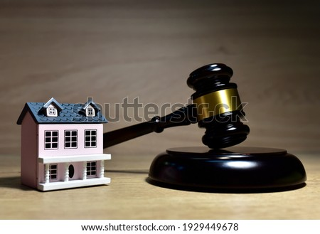 Real Estate Purchase and Sale Transaction Litigation. Sale of Real Property Lawyer. Seller backs out of transaction. House and Mallet of judge in courtroom. Legal excuse and Justice concept.