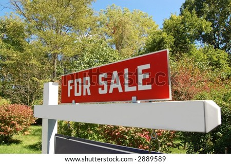 Real estate sign on land for sale - stock photo