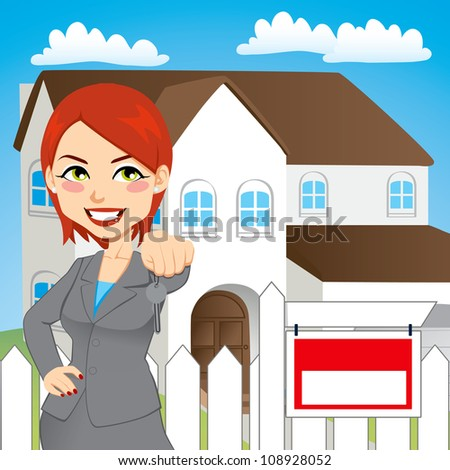 Real estate woman holding the key of a new house