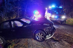 Real event. Car accident. The car crashed at night on a wet road . Car accident over raining day in autumn time. Rescuers help with car accident, ambulance, fire and police.