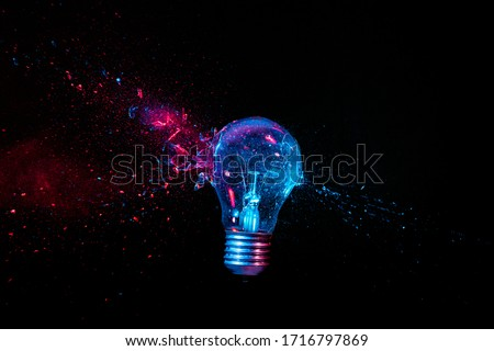 real explosion of a tungsten filament bulb. high speed photography. black background. concept of obsolete energy, crisis, fragility. ストックフォト ©