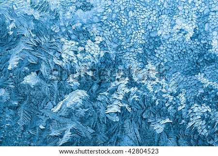 Real frosty patterns on the window in december - stock photo