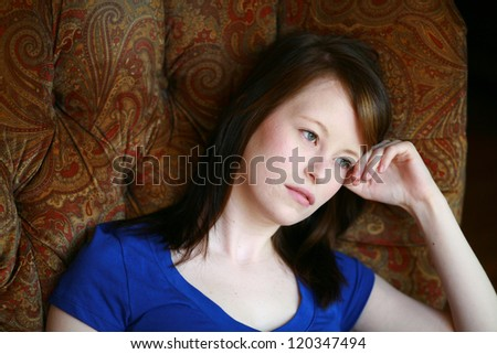 real girl looking out in resting head on hand