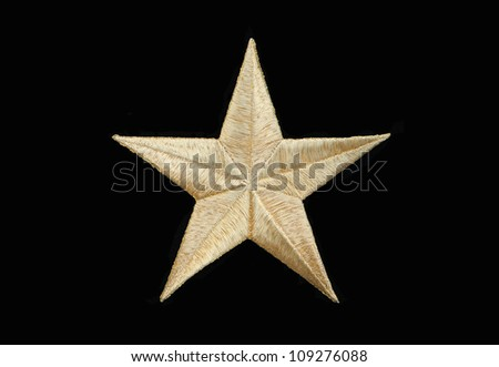 Real Gold Star isolated on black background