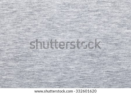 Real heather grey knitted fabric made of synthetic fibres textured background